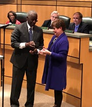 Anderson Mayor Terence Roberts presents a key to the city to Linda McConnell, who is retiring Friday after 41 years as a city employee, including the past three years as city manager.