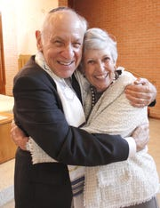 Rabbi Arnold Task and his wife, Judy, embrace at the end of the religious portion of his retirement Shabbat in 2011.