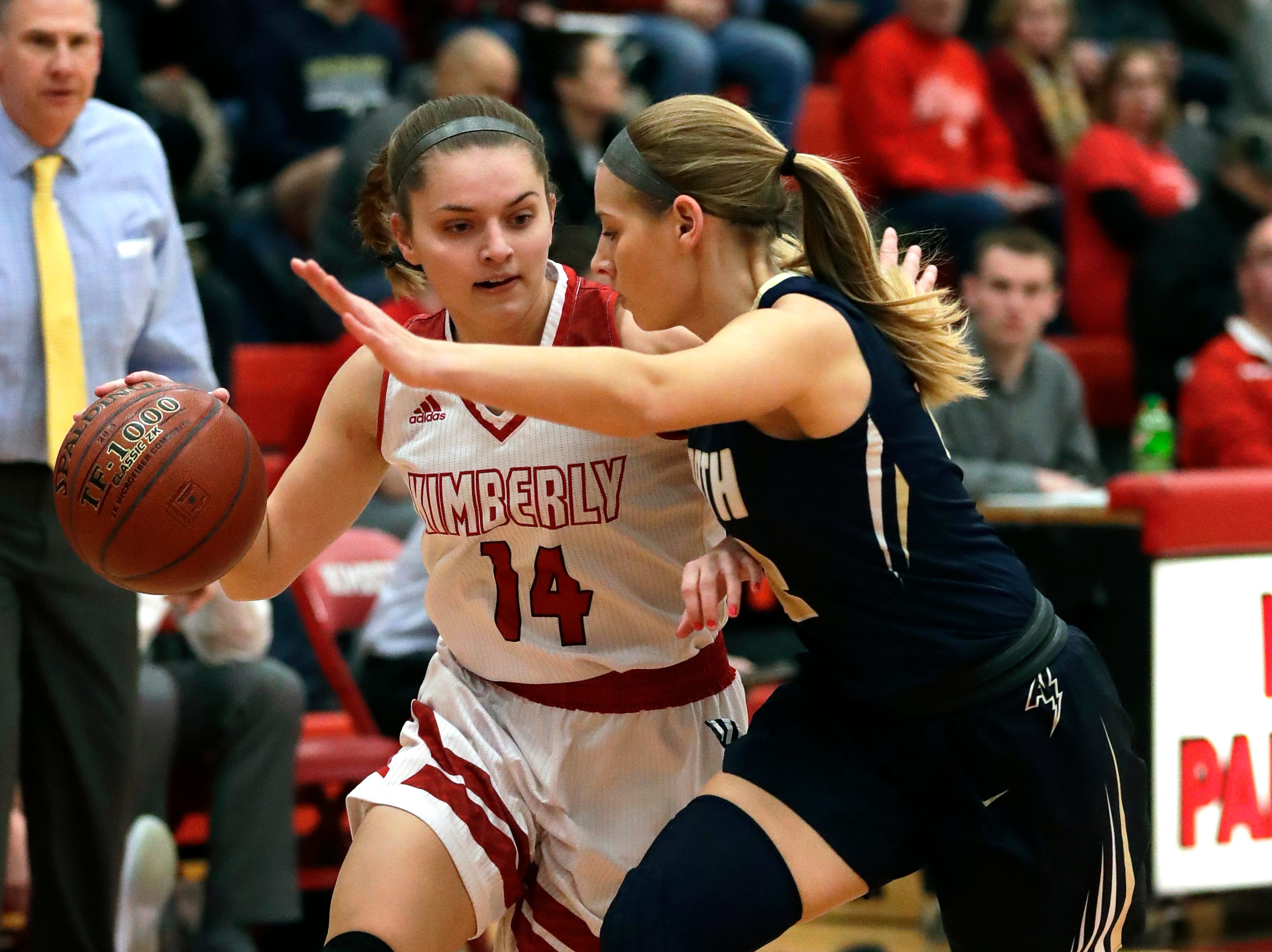 Kimberly High School's Taylor Hietpas (14) drives to the basket against Appleton North High School's Teagan Prusinski (12) during their girls basketball game Monday, February 11, 2019, in Kimberly, Wis. Dan Powers/USA TODAY NETWORK-Wisconsin