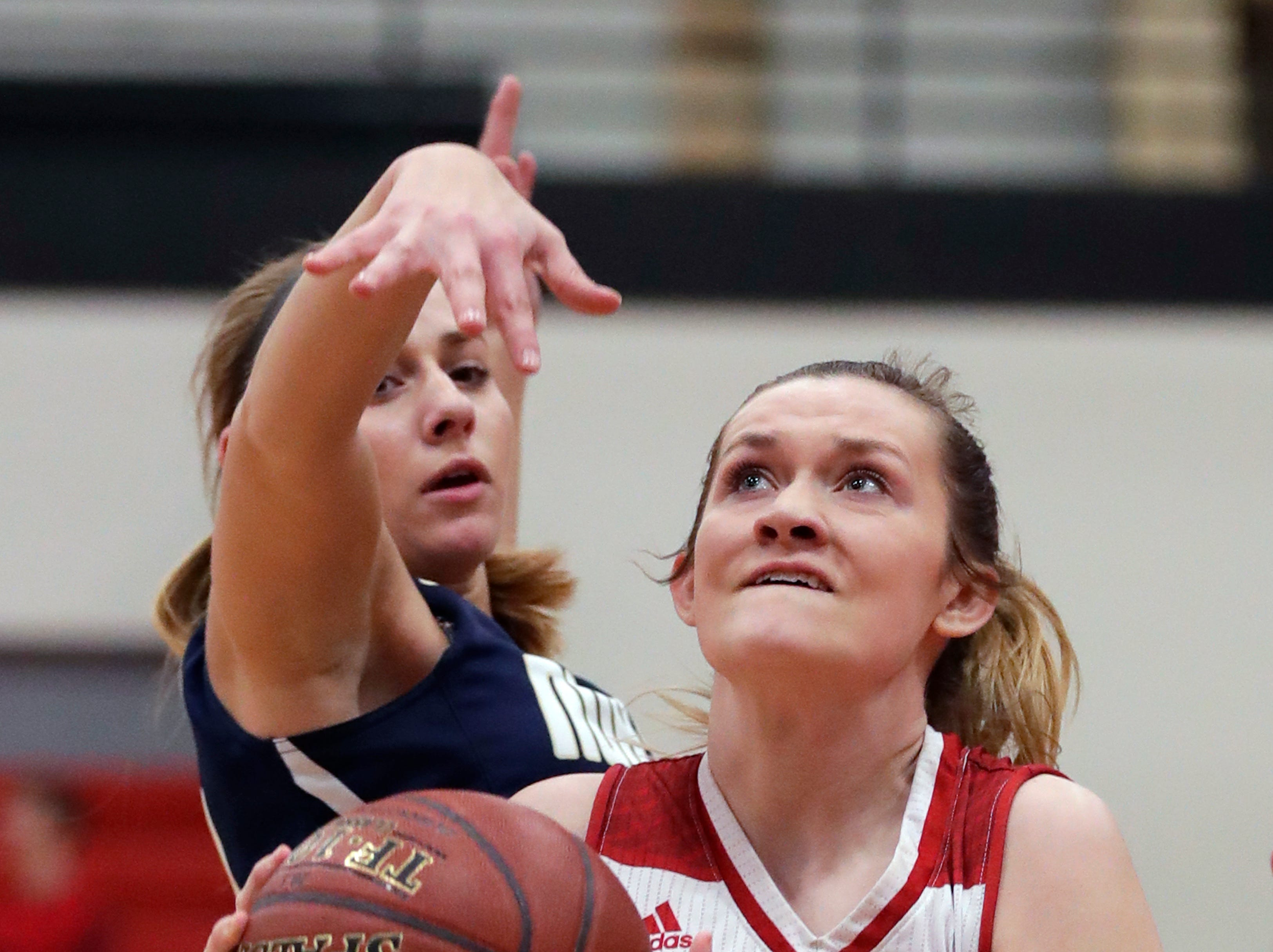 Kimberly High School's Kennedy Litvinoff (22) drives to the basket against Appleton North High School's Teagan Prusinski (12) during their girls basketball game Monday, February 11, 2019, in Kimberly, Wis. Dan Powers/USA TODAY NETWORK-Wisconsin