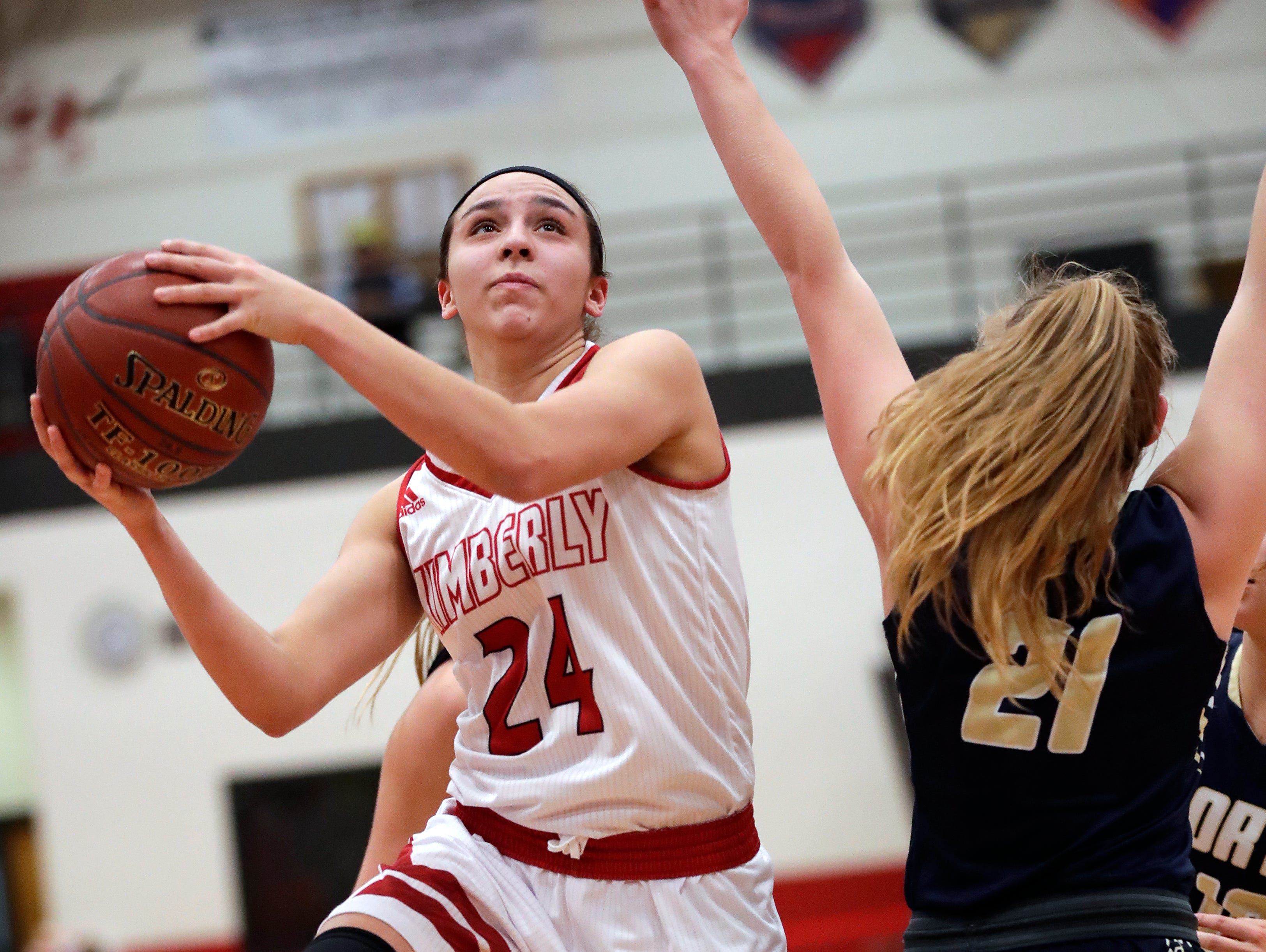 Kimberly High School's Shea Dechant (24) puts up a shot against Appleton North High School's Lilli Van Handel (21) during their girls basketball game Monday, February 11, 2019, in Kimberly, Wis. Dan Powers/USA TODAY NETWORK-Wisconsin