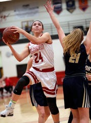 Kimberly's Shea Dechant (24) puts up a shot against Appleton North's Lilli Van Handel (21) during their girls basketball game Monday in Kimberly.
