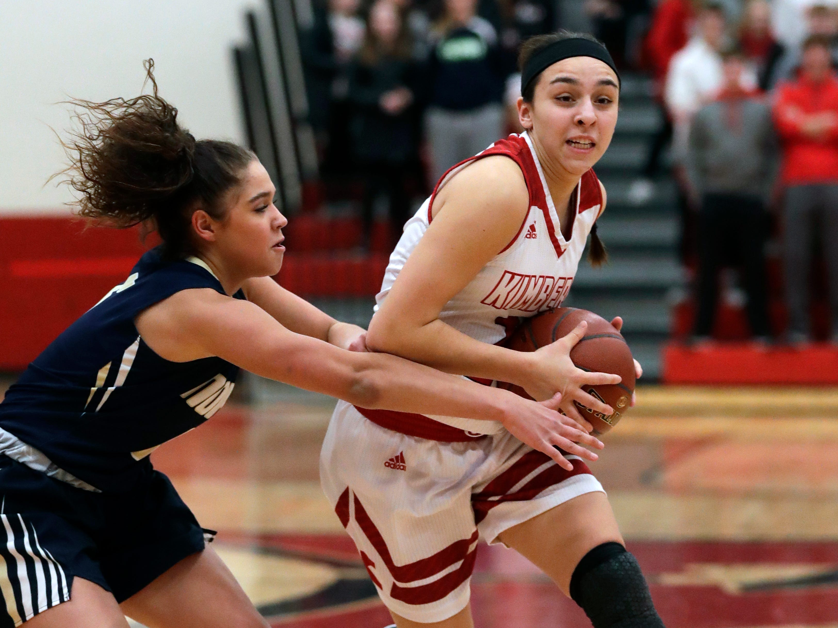 Appleton North High School's Niki Van Wyk, left, defends against Kimberly High School's Shea Dechant during their girls basketball game Monday, February 11, 2019, in Kimberly, Wis. Dan Powers/USA TODAY NETWORK-Wisconsin