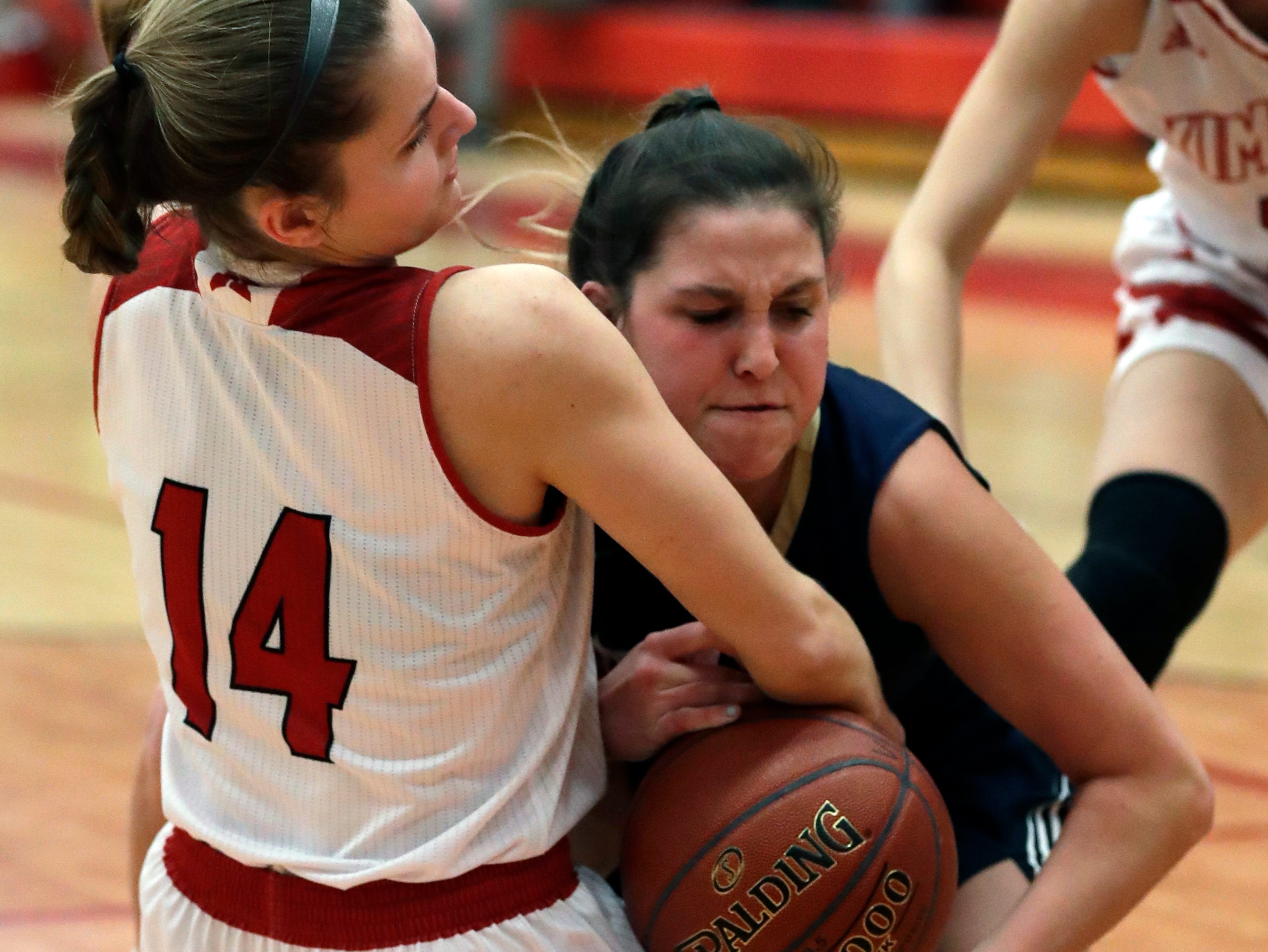 Kimberly High School's Taylor Hietpas (14) battles for a loose ball against Appleton North High School's Paige Schabo (23) during their girls basketball game Monday, February 11, 2019, in Kimberly, Wis. Dan Powers/USA TODAY NETWORK-Wisconsin
