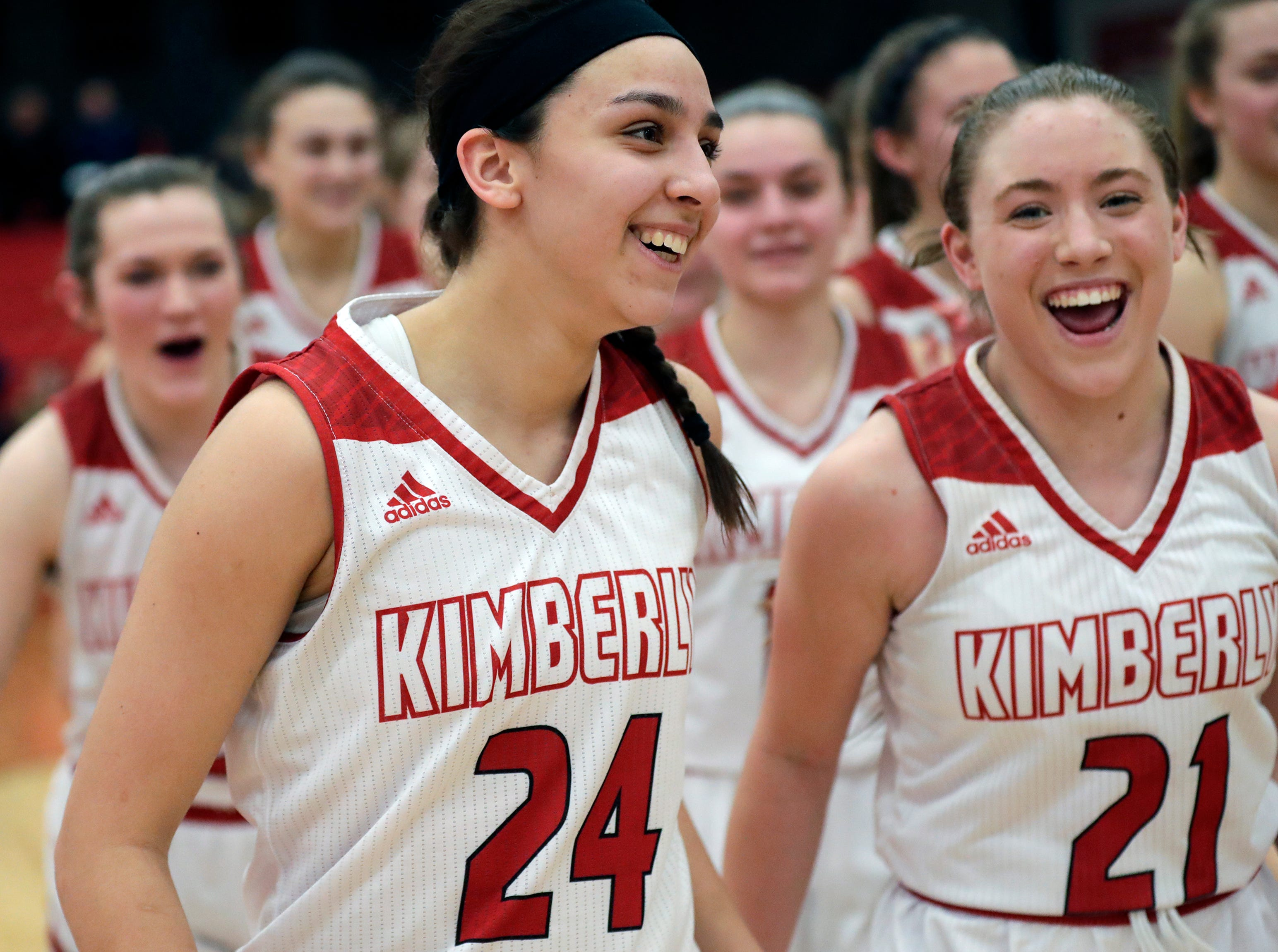 Kimberly High School's Shea Dechant (24) and Kate Karch (21) celebrate their 52-48 victory against Appleton North High School during their girls basketball game Monday, February 11, 2019, in Kimberly, Wis. Dan Powers/USA TODAY NETWORK-Wisconsin