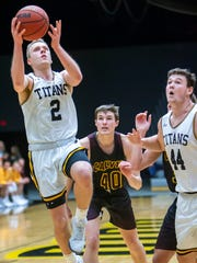 Ben Boots puts up a shot for UW-Oshkosh as Jack Flynn, right, watches during a game against Calvin College earlier this season at Kolf Sports Center.