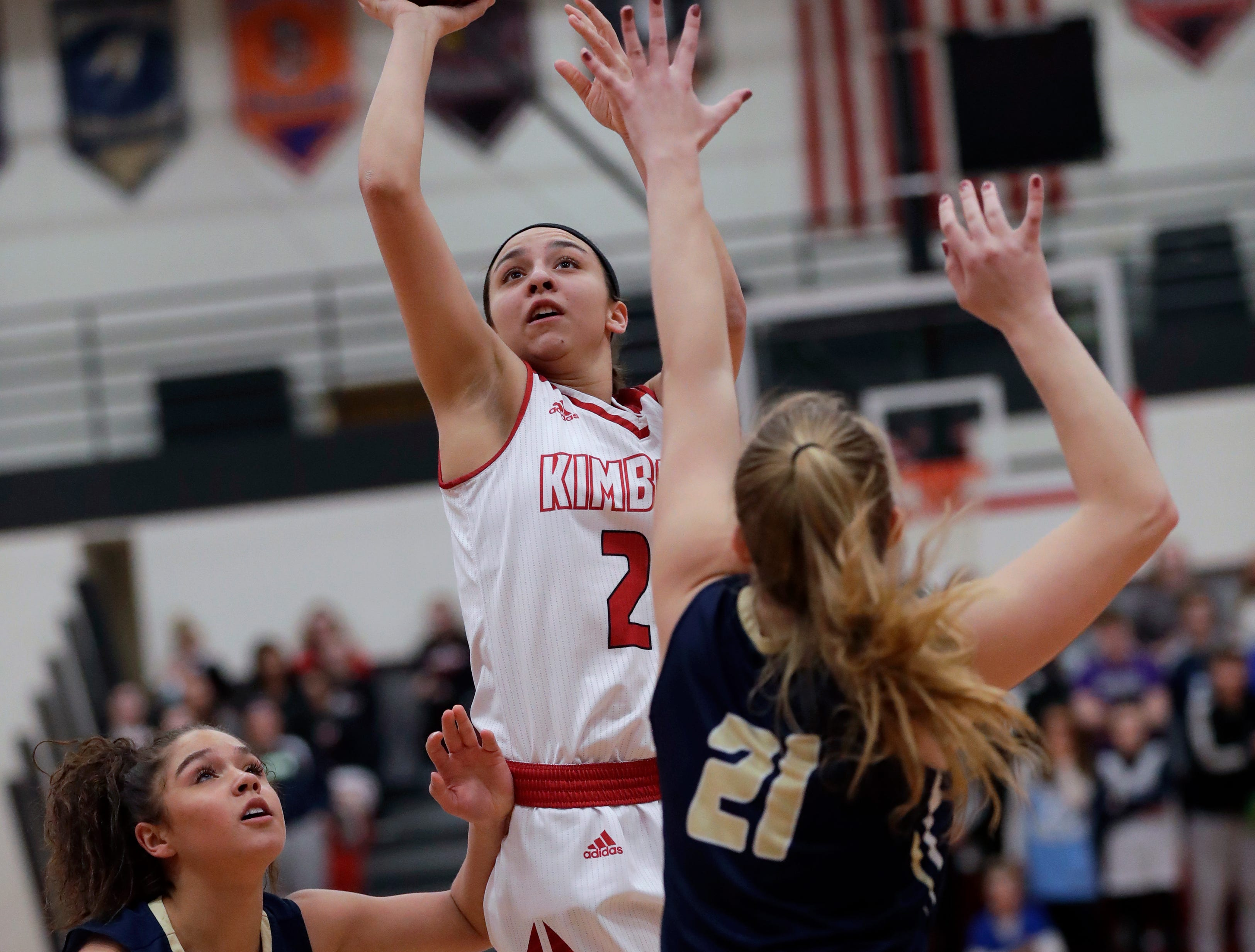 Kimberly High School's Shea Dechant (24) puts up a shot against Appleton North High School's Niki Van Wyk (5) and Lilli Van Handel (21) during their girls basketball game Monday, February 11, 2019, in Kimberly, Wis. Dan Powers/USA TODAY NETWORK-Wisconsin