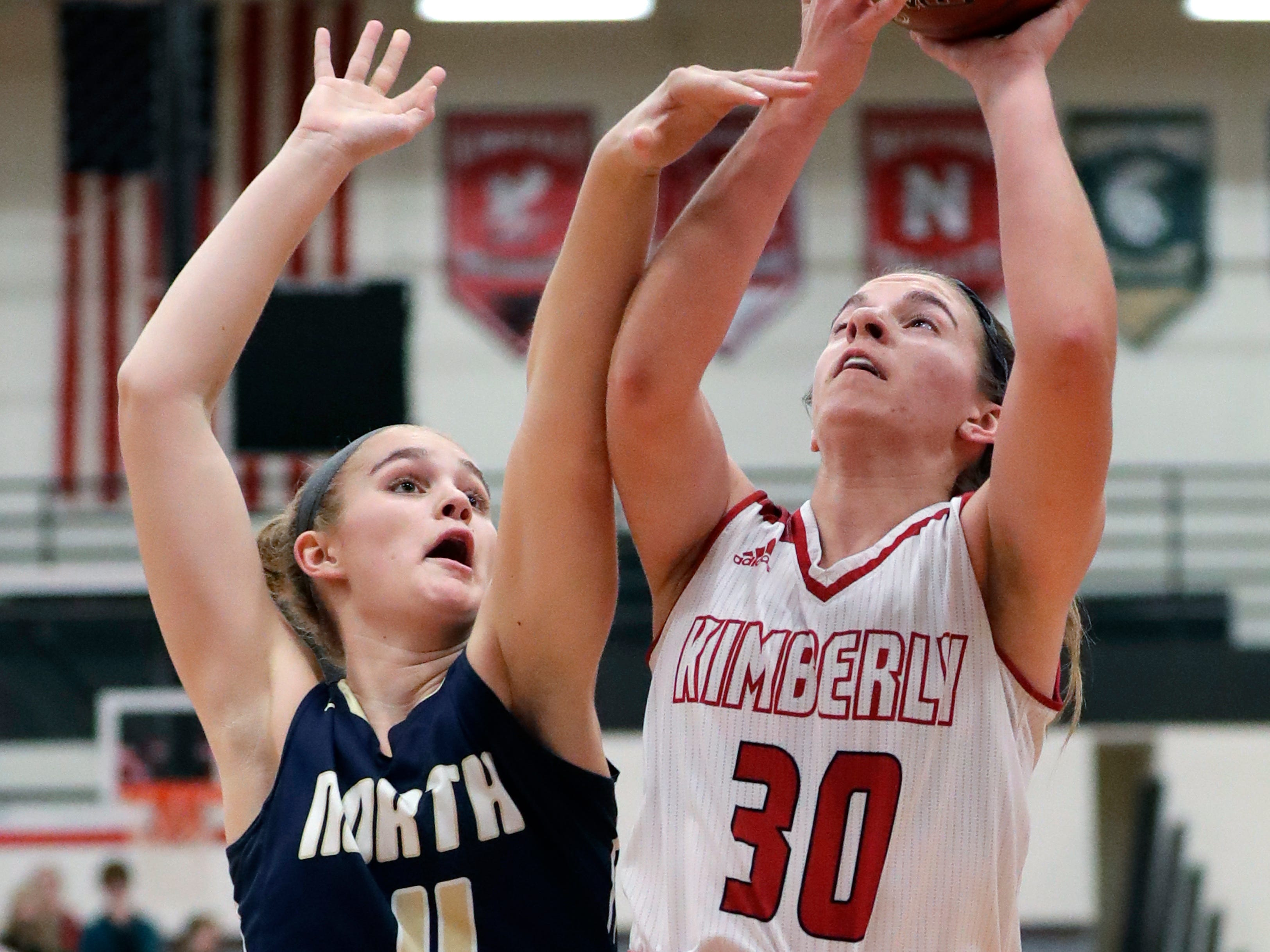 Kimberly High School's Marissa Murray (30) is fouled as she puts up a shot against Appleton North High School's Emma Erickson (11) during their girls basketball game Monday, February 11, 2019, in Kimberly, Wis. Dan Powers/USA TODAY NETWORK-Wisconsin