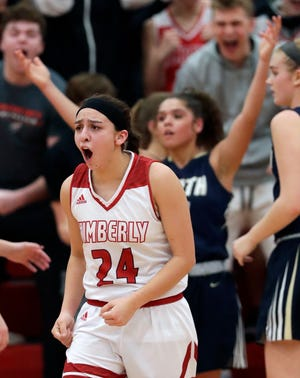 Kimberly's Shea Dechant (24) reacts after making a shot and getting fouled to give her team the lead late in the game against Appleton North on Feb. 11. The Papermakers won the FVA title.