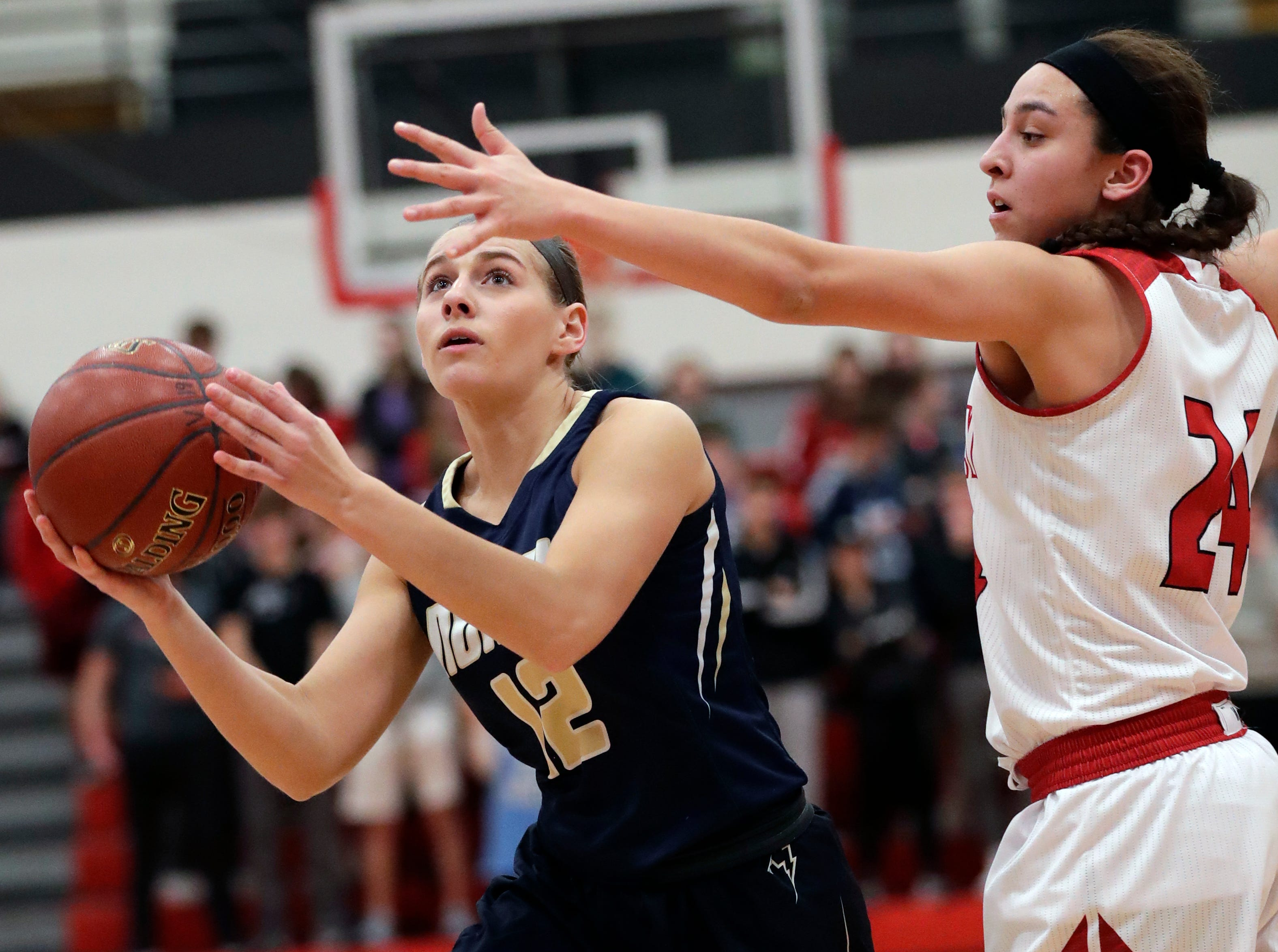Appleton North High School's Teagan Prusinski (12) puts up a shot against Kimberly High School's Shea Dechant (24) during their girls basketball game Monday, February 11, 2019, in Kimberly, Wis. Dan Powers/USA TODAY NETWORK-Wisconsin