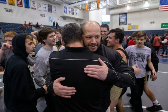 Southern Regional head coach John Stout hugs Rams' assistant coach Dan Roy after Southern won the NJSIAA Group V championship.