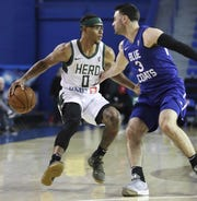 Trevon Duval of the Wisconsin Herd (left) takes on Blue Coats' Matt Farrell in G-League play at the Bob Carpenter Center.
