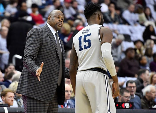 Georgetown Hoyas head coach Patrick Ewing talks with center Jessie Govan (15) during the first half against the Butler Bulldogs