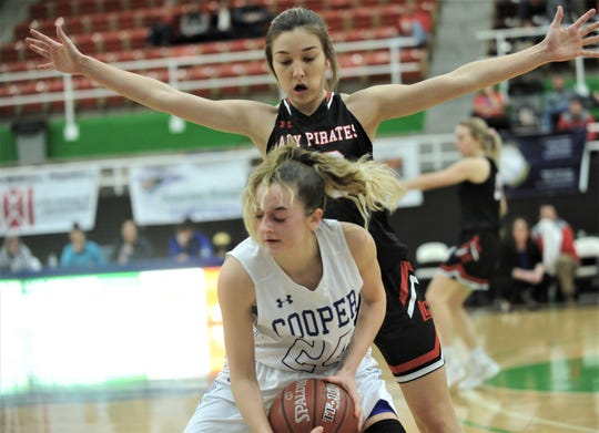 Lubbock-Cooper's Autumn Moore defends against Abilene Cooper's Meri Tetaj in the second half. Lubbock-Cooper beat the Lady Cougars 63-39 in the Region I-5A bi-district girls basketball playoff game Monday, Feb. 11, 2019, at The Coliseum in Snyder.