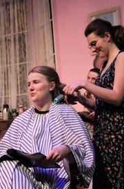"Annelle (Cheney Emberg, right), the new girl at Truvy's salon, works on M'Lynn's (Victoria Steffins) hair while M'Lynn banters back and forth with her daughter across the room in this rehearsal scene from Abilene Christian University's winter comedy, ""Steel Magnolias."""