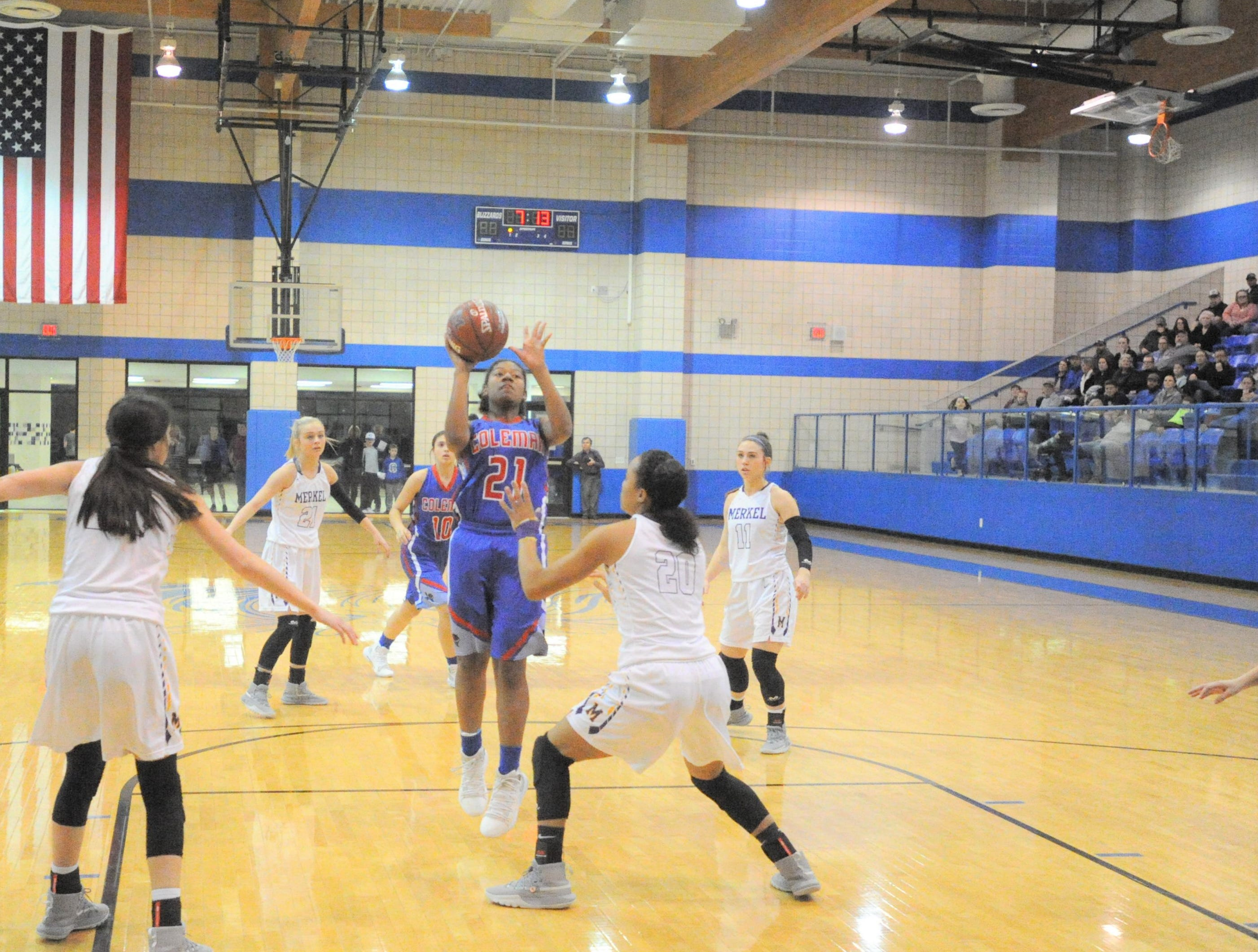 Coleman senior Damara Thomas (21) goes up for a shot in the lane against Merkel in a bi-district playoff at Winters High School on Monday, Feb. 11, 2019.