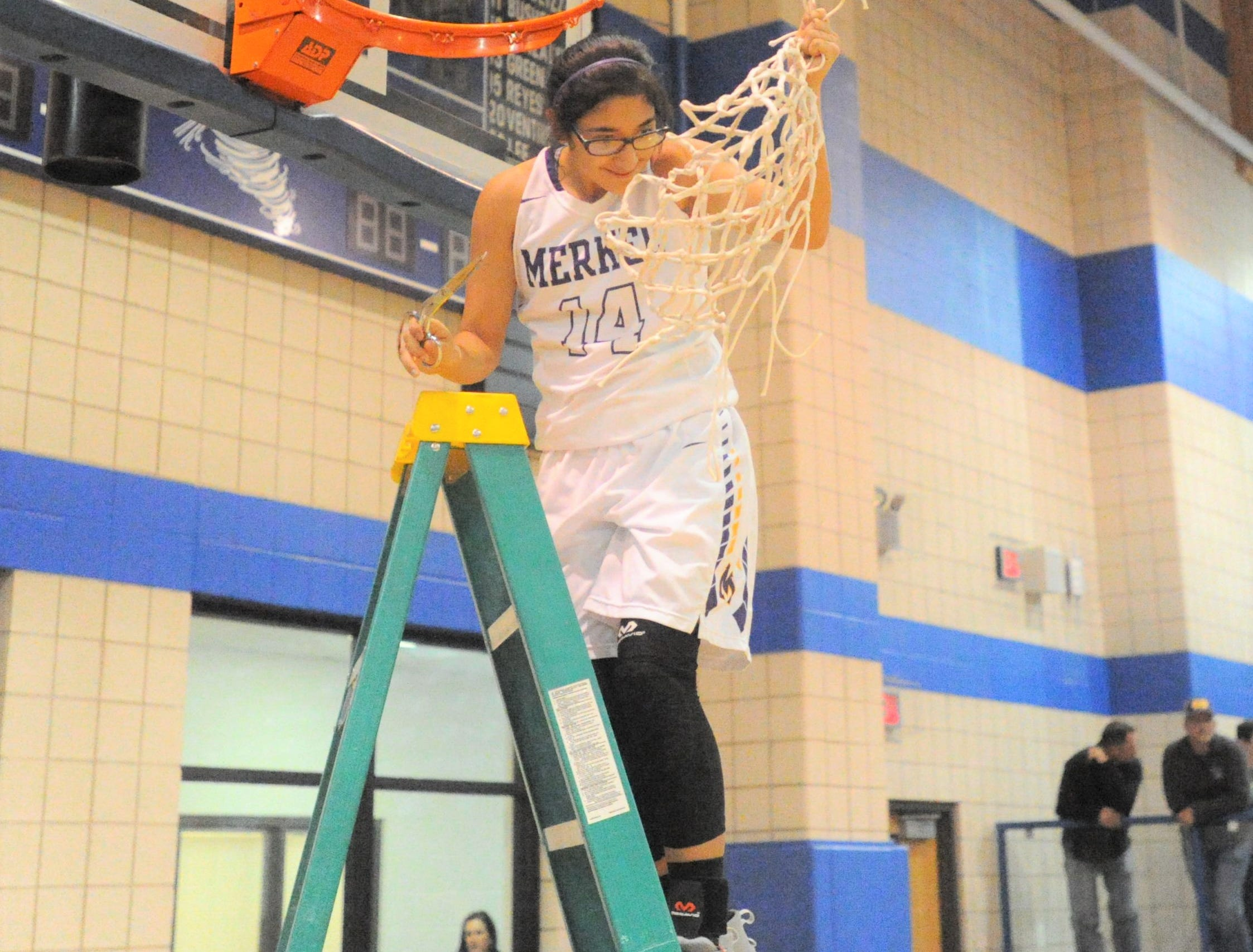 Merkel senior Mireya Salazar holds up the net at Winters High School on Monday, Feb. 11, 2019, following the Lady Badgers' 49-33 win over Coleman.