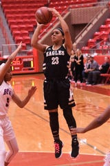 Abilene High's Alyssa Washington (23) pulls up for a jumper against Arlington Bowie in a Region I-6A bi-district playoff at Glen Rose on Monday, Feb. 11, 2019.