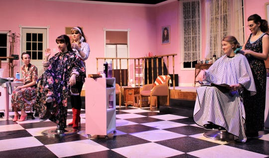 """Truvy (Jessica Harms) works with Shelby (Lauren McDonald, both at left) while Annelle (Cheney Emberg) puts curlers in the hair of M'Lynn (Victoria Steffins, both right) as Clairee (Nicole Sutphen, far left) listens in on Shelby's wedding day in this rehearsal scene from """"Steel Magnolias,"""" Abilene Christian University's winter comedy."""