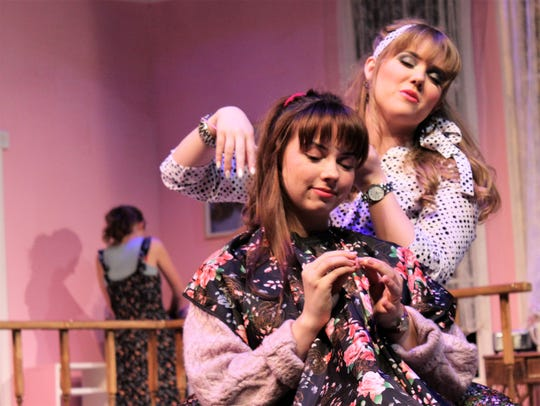 """Truvy (Jessica Harms, right) combs the hair of Shelby (Lauren McDonald) in her home-based beauty shop in this rehearsal scene from """"Steel Magnolias,"""" Abilene Christian University's winter comedy."""