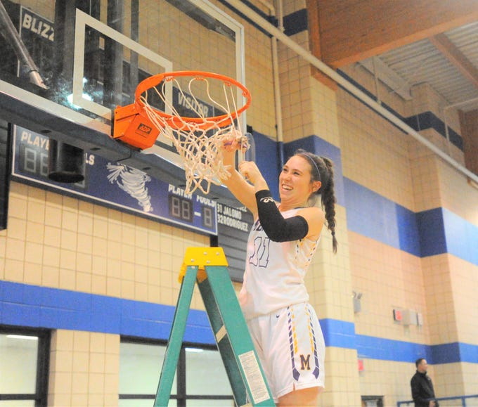Merkel junior guard Kaydi Pursley cuts a piece of the net at Winters High School on Monday, Feb. 11, 2019, following the Lady Badgers' 49-33 win over Coleman.