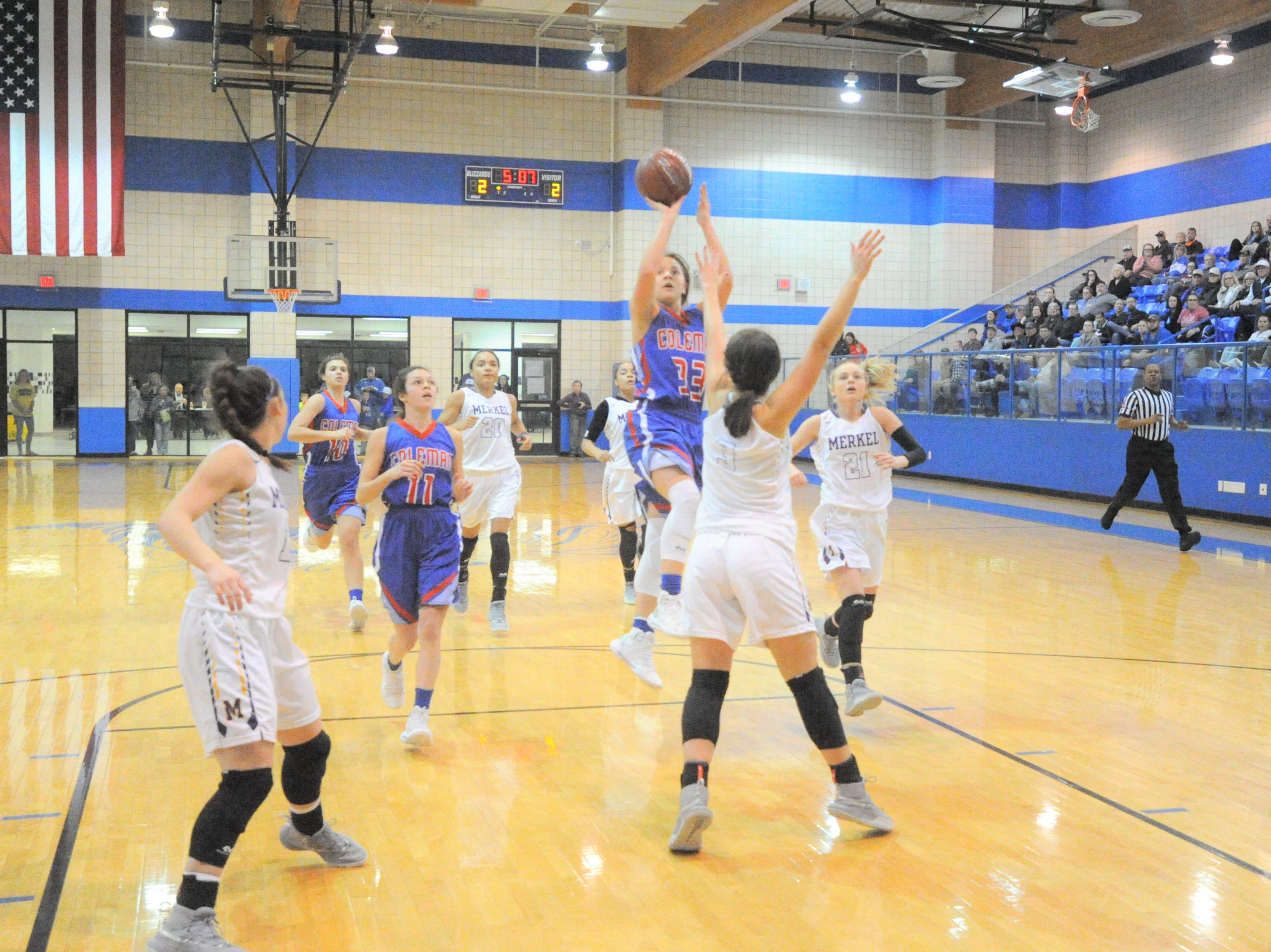 Coleman junior Ginny Arnold (33) gets ready to take a shot against Merkel in a bi-district playoff at Winters High School on Monday, Feb. 11, 2019.