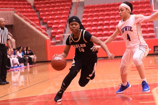 Abilene High's Trakenya Roberson (24) drives past Arlington Bowie's Alexis Smith (4) in a Region I-6A bi-district playoff at Glen Rose on Monday, Feb. 11, 2019.