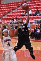 Abilene High's Trakenya Roberson (24) goes around a Arlington Bowie defender for a layup in a Region I-6A bi-district playoff game on Feb. 11 at Glen Rose.