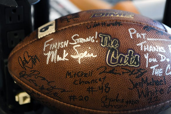 A football signed by members of the Western Carolina University football team sits on Pat Ryan's desk at the Asheville Radio Group as a sign of support as he battles colon cancer.