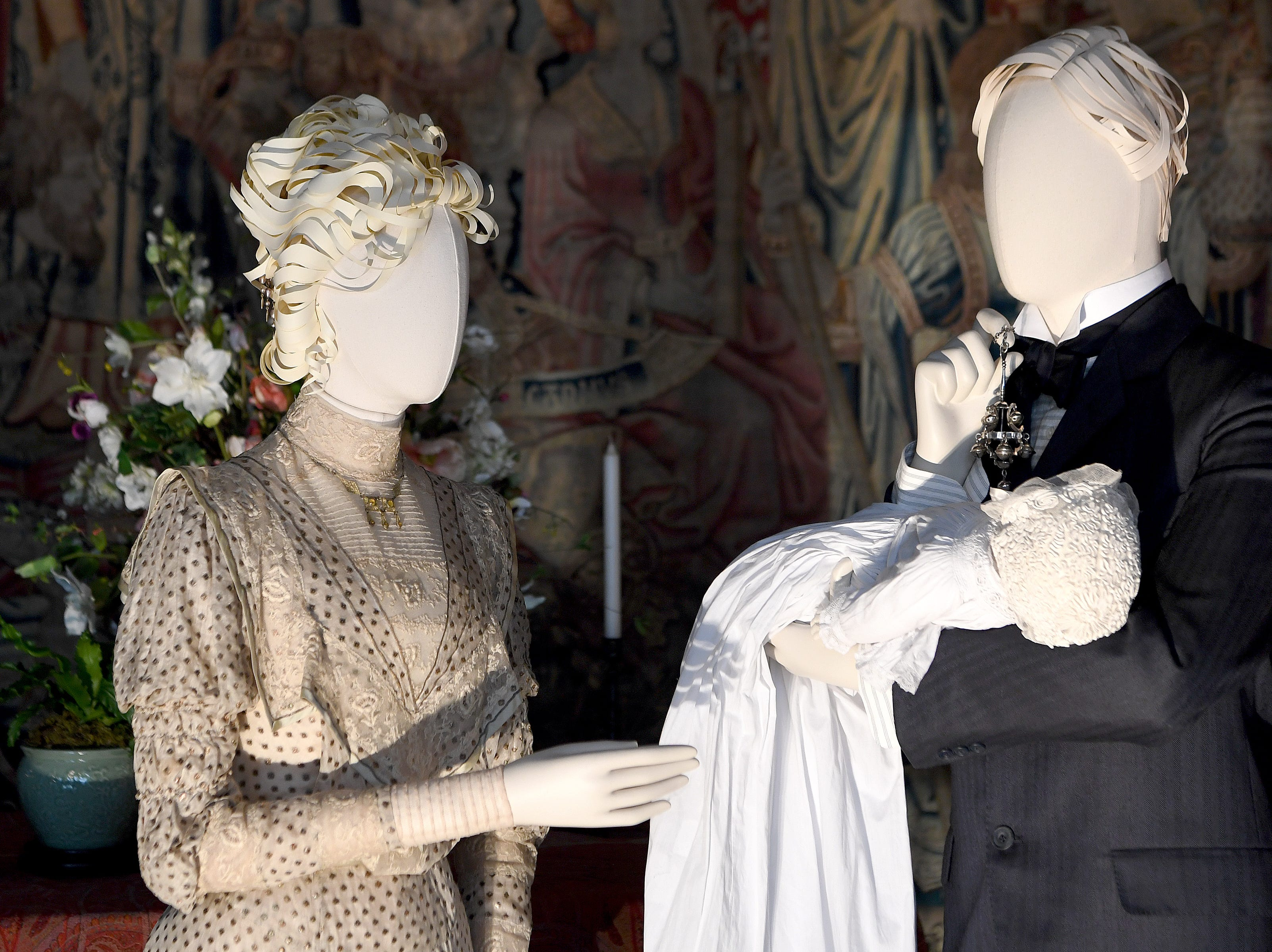 """Outfits recreated from photographs of Edith and George Vanderbilt, with their infant daughter Cornelia, are on display in the tapestry gallery of the Biltmore House for """"A Vanderbilt House Party, the Gilded Age,"""" on Feb. 7, 2019. Cornelia was born at Biltmore in 1900."""