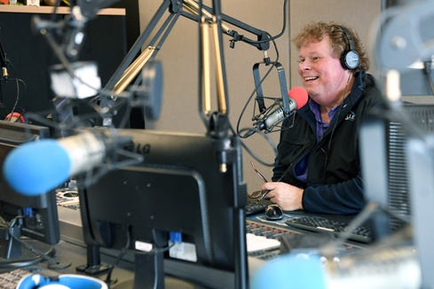 Pat Ryan hosts his sports radio talk show, the WISE Guys, from the Asheville Radio Group building on Feb. 6, 2019. In September 2018 Ryan was diagnosed with colon cancer and has been continuing to host the show while receiving treatment.