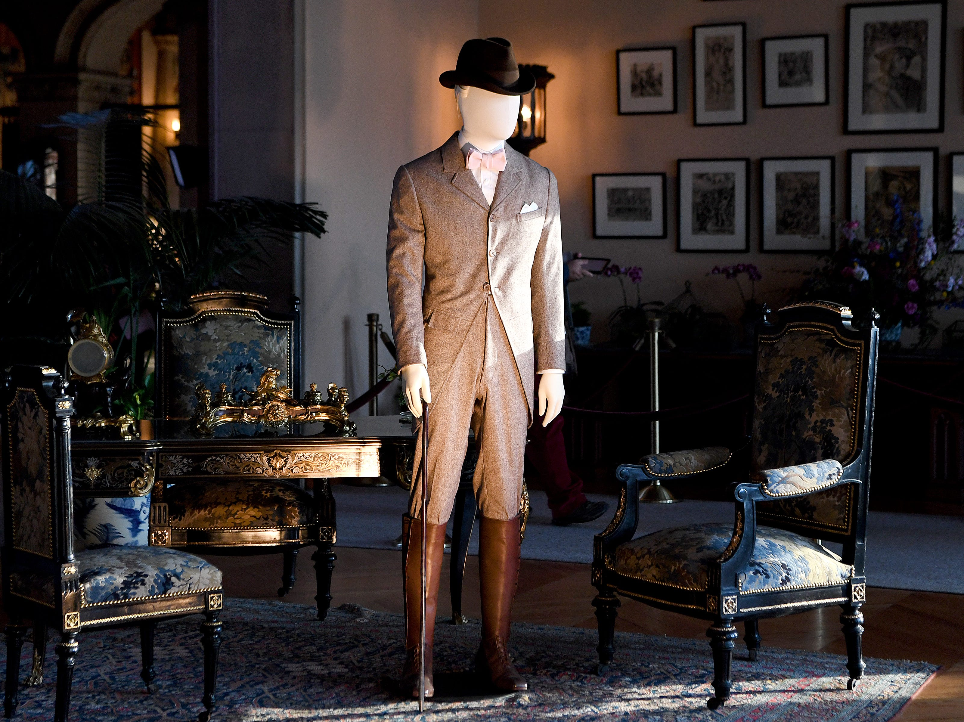 """An outfit representing what George Vanderbilt would have worn walking the grounds of the Biltmore is displayed in the salon of the Biltmore House for """"A Vanderbilt House Party, the Gilded Age,"""" on Feb. 7, 2019."""