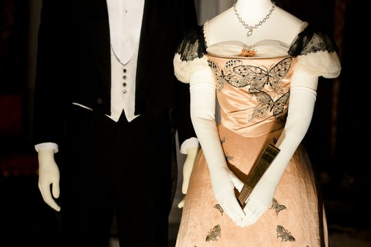 """Clothing based on photographs of Hamilton McKown Twombly and his wife, Florence Vanderbilt Twombly, George Vanderbilt's sister, are on display in the banquet hall of the Biltmore House for """"A Vanderbilt House Party, the Gilded Age."""" The exhibit will be on display until May 27."""