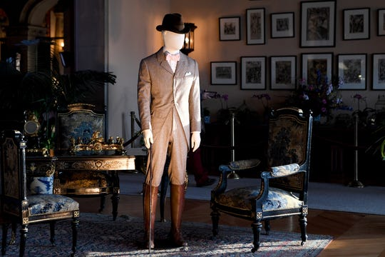 """An outfit representing what George Vanderbilt would have worn walking the grounds of the Biltmore is displayed in the salon of the Biltmore House for """"A Vanderbilt House Party, the Gilded Age,"""" on Feb. 7, 2019. The exhibit will be on display until May 27."""