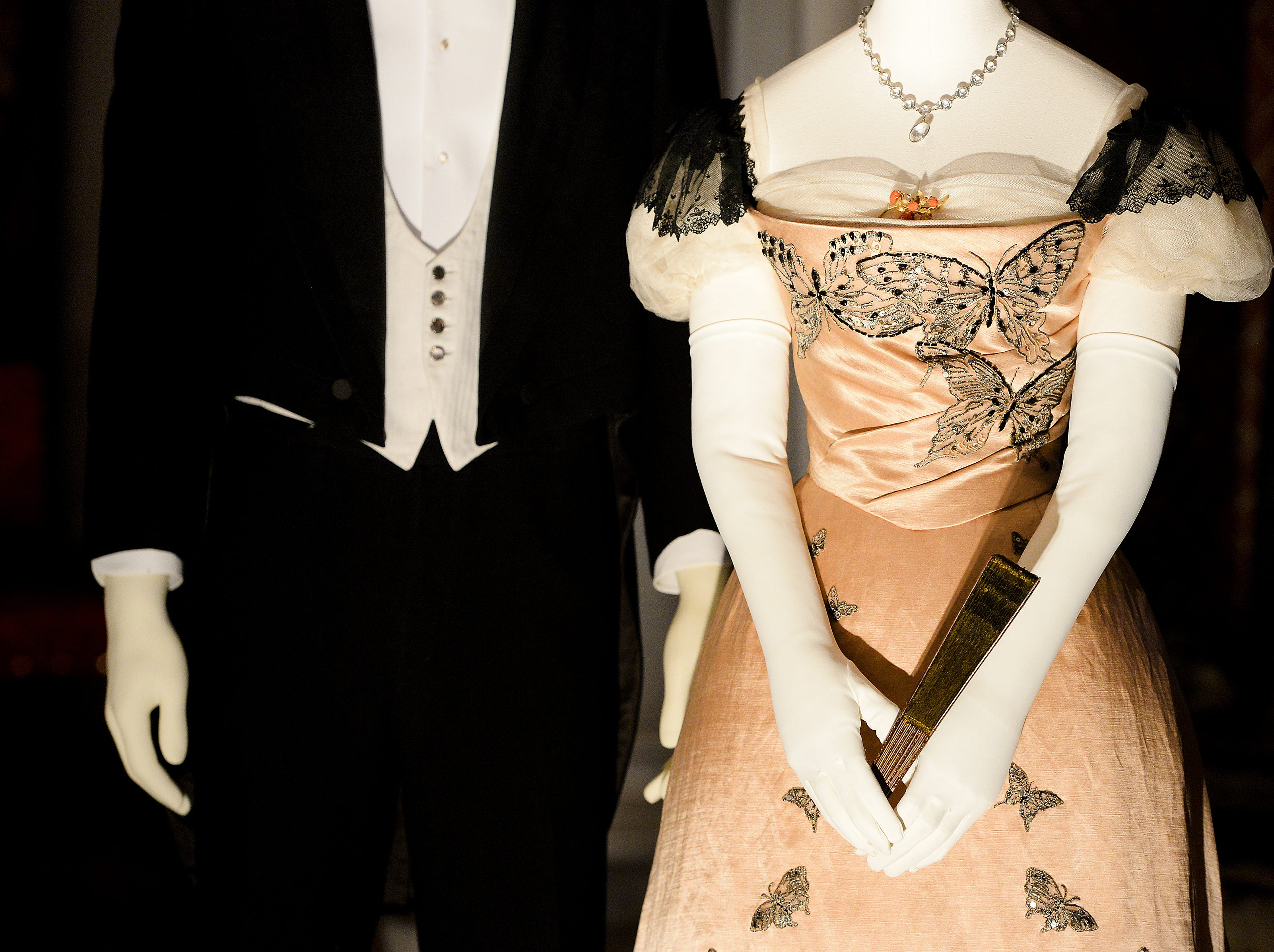 """Clothing based on photographs of Hamilton McKown Twombly and his wife, Florence Vanderbilt Twombly, George Vanderbilt's sister, are on display in the banquet hall of the Biltmore House for """"A Vanderbilt House Party, the Gilded Age."""""""