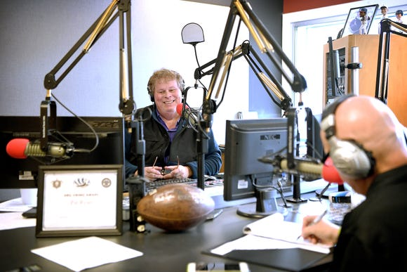 Pat Ryan hosts his sports radio talk show, the WISE Guys, with regular contributor, longtime high school football coach Charlie Metcalf from the Asheville Radio Group building on Feb. 6, 2019. In September 2018 Ryan was diagnosed with colon cancer and has been continuing to host the show while receiving treatment.