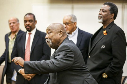 Battle Creek's Tony McGee, right, along with members of the Black 14 talk to an audience at University of Wyoming during a Black History Month event over the weekend.