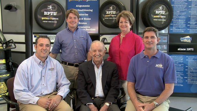 Mike Gatto, center, founder of Gatto's Tires & Auto Service, died Monday. He was 93. Pictured, from left, grandson-in-law Mike Nevin, grandson Mike, Mike Gatto, daughter Pam Gatto-Gallo and grandson Scott McHenry.