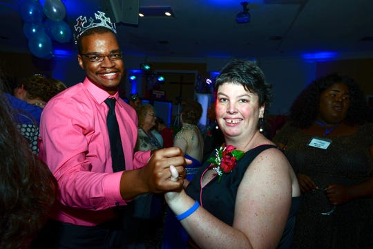 Malcolm Harris-Gowdie and Talona Berner share a dance at the Treasure Coast Night to Shine event, sponsored by the Tim Tebow Foundation and hosted by Genesis Community Church in Fort Pierce.