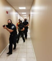 Palm Bay Police Chief James Roger leads a live-action shooting exercise last year at a church in Palm Bay.