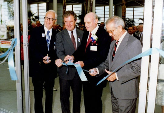 Shown at the June 7, 1990, ribbon cutting and dedication ceremony for Melbourne Airport's new terminal are, from left, Joseph Mullins, mayor of Melbourne; Garland Castleberry, Regional Administrator/FAA Southern Region; Edward L. Foster, director of aviation; and Mike Gatto, chairman, Melbourne Airport Authority.