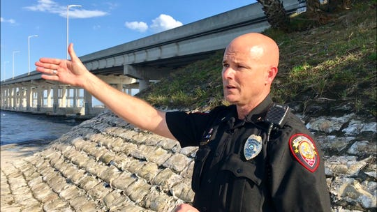 Melbourne Police Cmdr. Marc Claycomb gestures toward the Indian River Lagoon where a fisherman spotted a body Tuesday afternoon.