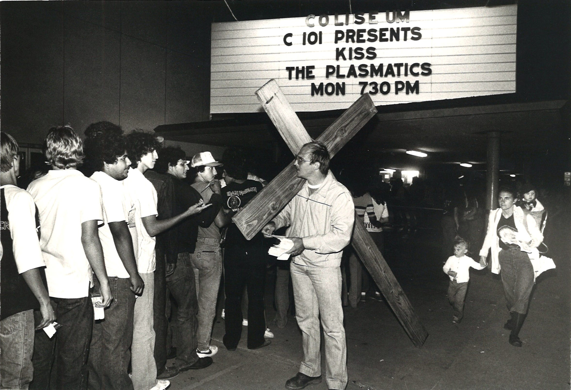 Michael Woroniecki (with cross) attempts to persuade concergoers to not see Kiss and The Plasmatics at Corpus Christi's Memorial Coliseum on March 14, 1983.