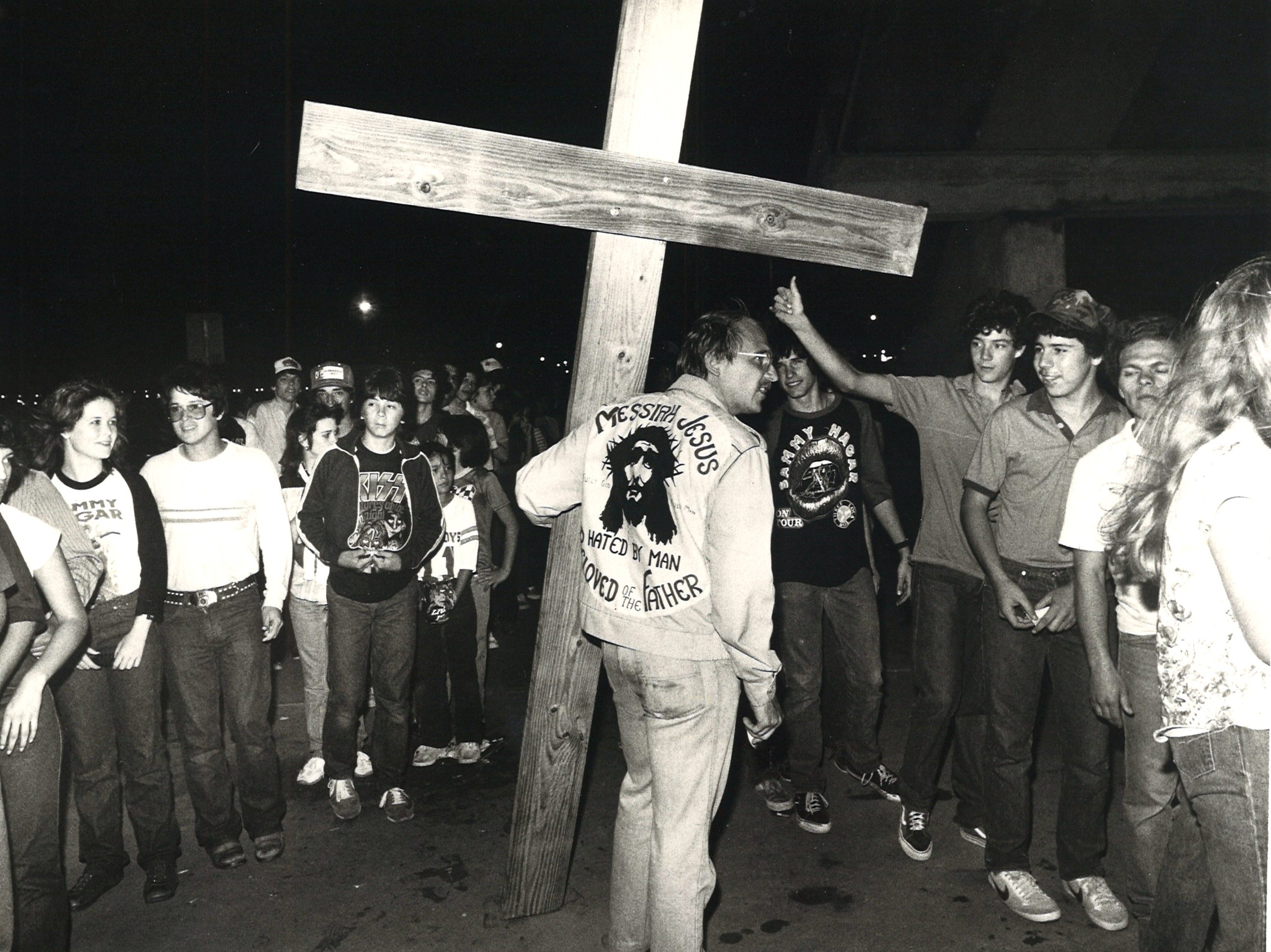 Michael Woroniecki (with cross), handed out religious tracts and preached to concergoers to avoid the Kiss concert at Corpus Christi's Memorial Coliseum on March 14, 1983.