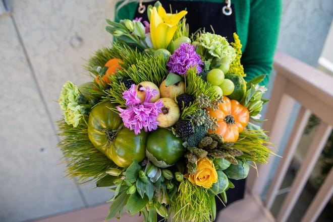 Julia Prokhorova owner of Wild Veggie Bouquet holds one of her arrangements on Tuesday, Jan. 29, 2019.