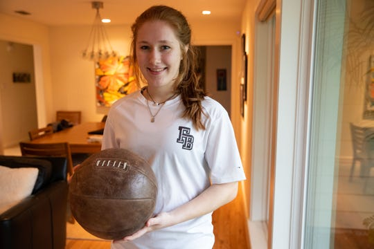 Claire Naismith holds a replica of an original basketball, her  great-great-grandfather James Naismith, the innovator of basketball.
