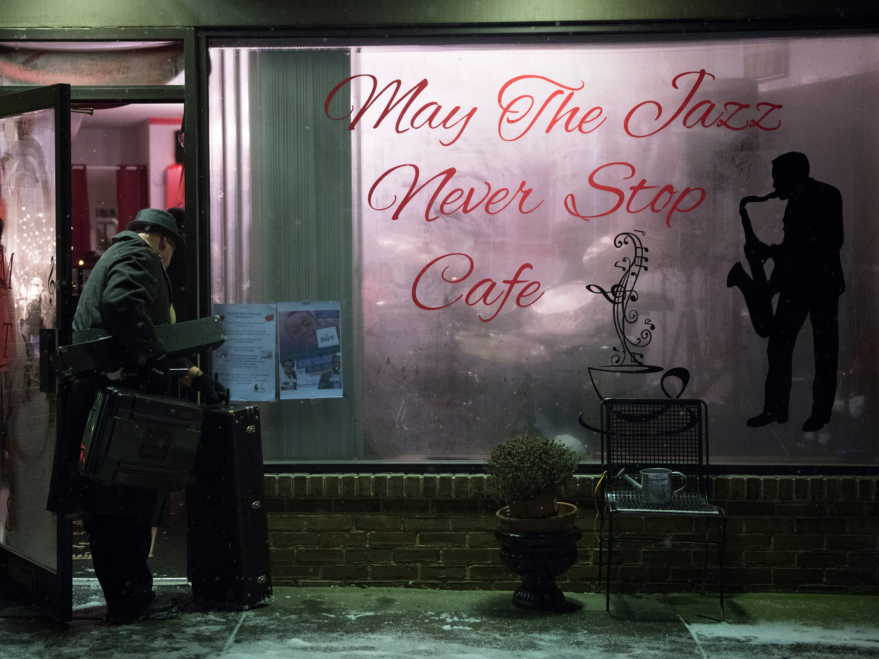 Jazz musician Dave Dowell of Atco carries his gear into May the Jazz Never Stop Jazz Cafe, prior to performing at the Haddon Heights jazz cafe.