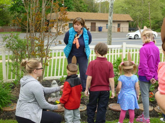 Lorraine Kiefer, owner of Triple Oaks Nursery in Franklinville, talks to children about gardening during a Franklin Township Library program in 2016. Triple Oaks will be among the New Jersey vendors at the 2019 Philadelphia Flower Show.
