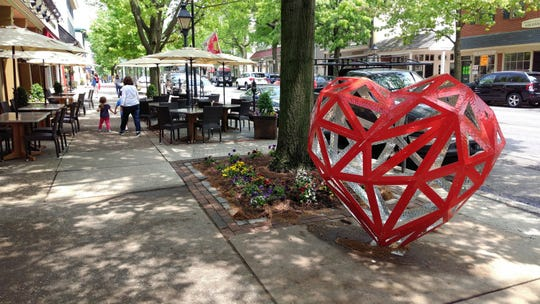 "Haddonfield Outdoor Sculpture Trust (HOST), a nonprofit art organization  committed to bringing accessible outdoor art to the Borough of Haddonfield, hosts Valentine's Day  activities at ""Low-Poly Open Heart,"" the bright red laser-cut aluminum sculpture by artist M.L. Duffy, located near the Tanner Street intersection at 115 Kings Highway East — one of more than 20 sculptures around town."
