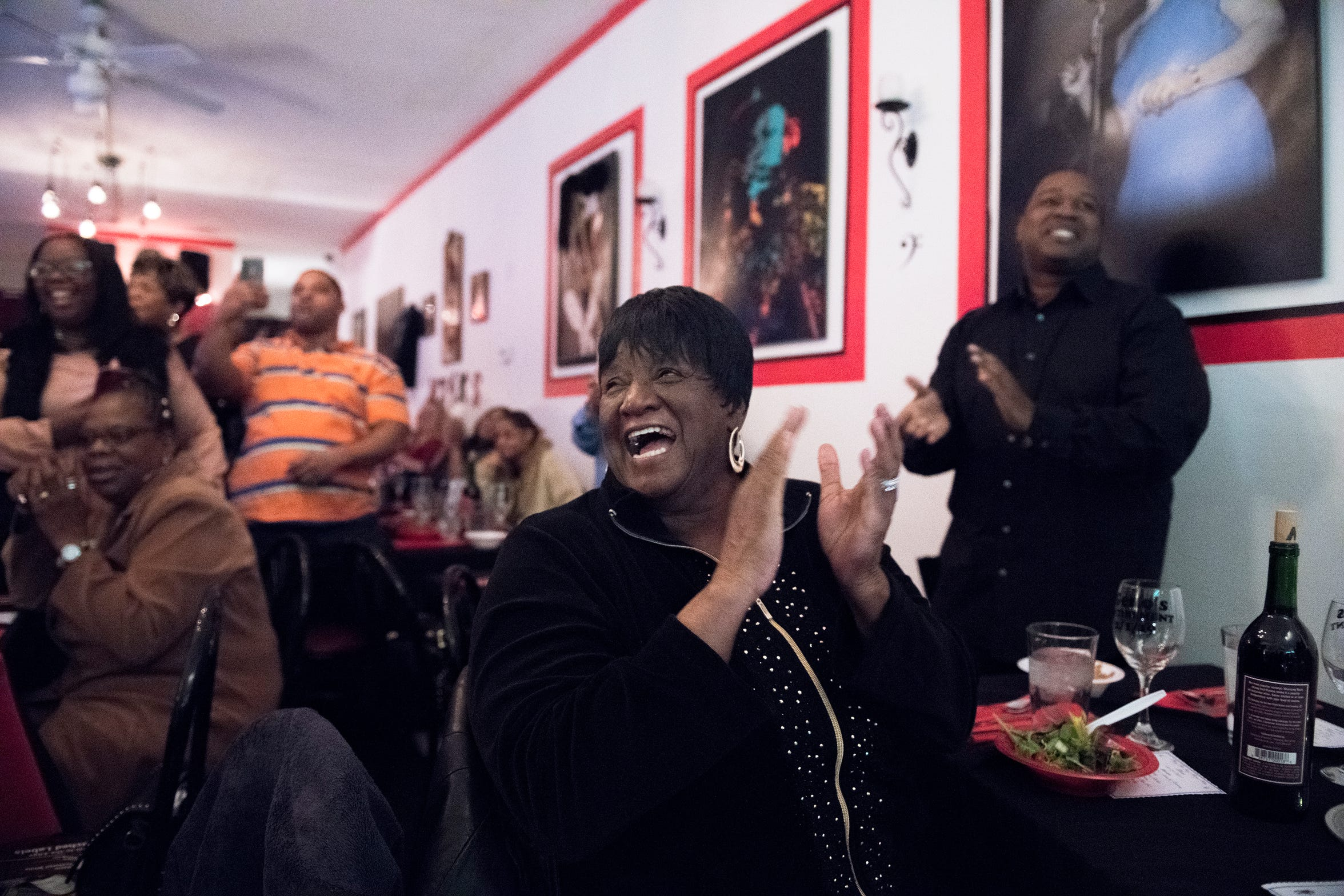 Darlene Wright of Sicklerville, center, celebrates the retirement of her friend Eugene Lambert of Camden, not pictured, at May the Jazz Never Stop Jazz Cafe in Haddon Heights.
